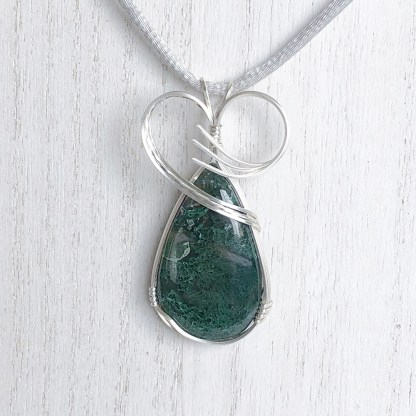reiki charged moss agate pendant