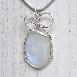 reiki charged rainbow moonstone pendant