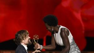 "Viola Davis, right, presents Peter Dinklage with the award for outstanding supporting actor in a drama series for ""Game of Thrones"" at the 67th Primetime Emmy Awards on Sunday, Sept. 20, 2015, at the Microsoft Theater in Los Angeles. (Photo by Chris Pizzello/Invision/AP)"