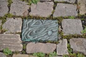 Wasserspuren Pflasterstein