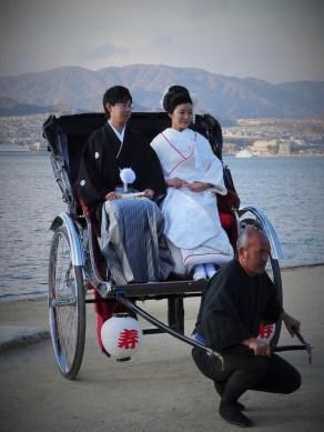 Couple in a rickshaw at Miyajima island.