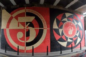 """Sedation Of Millions"" Street Art by Shepard Fairey an der Batemans Row in Shoreditch, London. ""It Takes the Sedation Of Millions To Hold Us Back"""