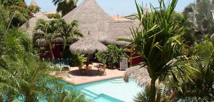 ACHTHONDERD EURO KORTING op 9-daagse tropische strandvakantie Aruba! Betaal slechts €691! Vlucht + Transfers + 3* Perle D'Or Hotel