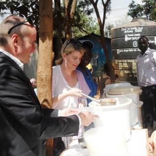 Ambassador Natasha Stott leads a feeding program at Stara Rescue Centre in Kibra.The meals are a means of fighting malnutrition and keep children in school. [Picture: Joyce Chimbi]