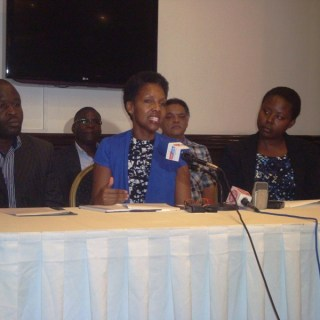 Wanjiru Gikonyo together with members of the Devolution Forum addressing the media on Transitional Authority exit. [Picture: Henry Owino ]