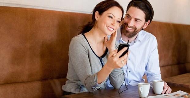 Couple with smartphone and earphones