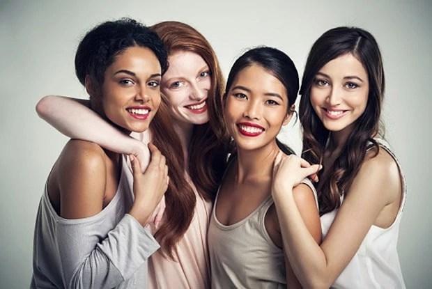 Close up of smiling women hugging