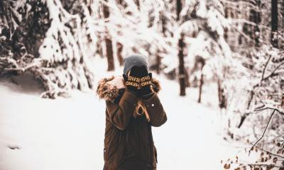 a shy girl staying in snow environment