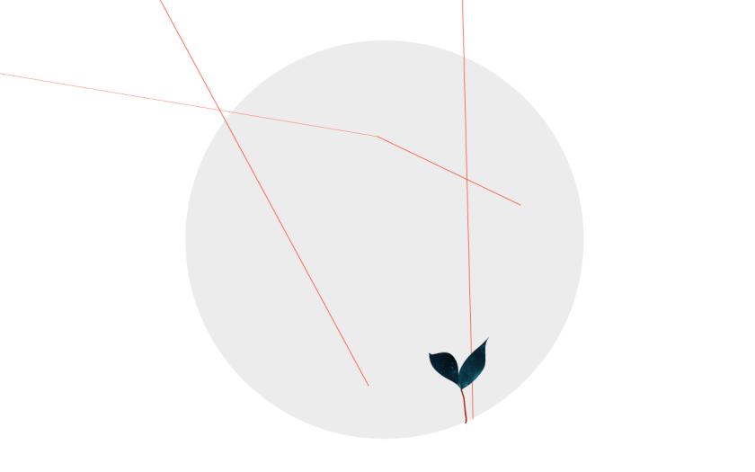 rund grå boll med röd tråd som förgrenar sig och liten planta