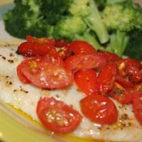 (español) Filetes de pescado con tomates cherry