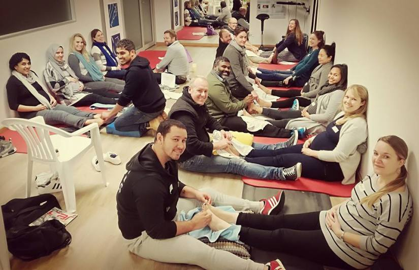 Hypnobirthing course attendees doing reflexology
