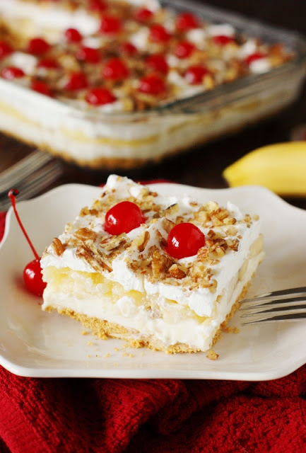 No-Bake Banana Split Cake by Tracey of TheKitchenIsMyPlayground.com