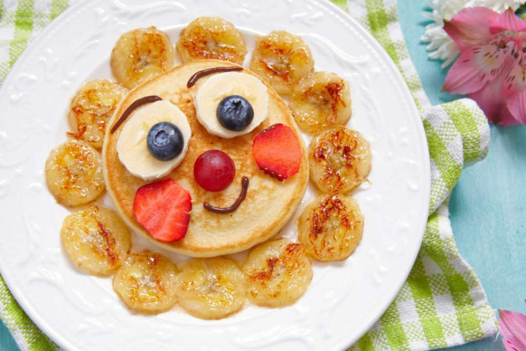 Mr Funny breakfast pancakes with fruits for kids