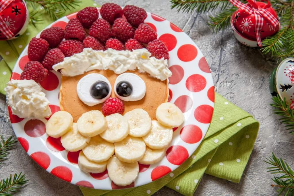 Christmas santa pancake with raspberry and banana