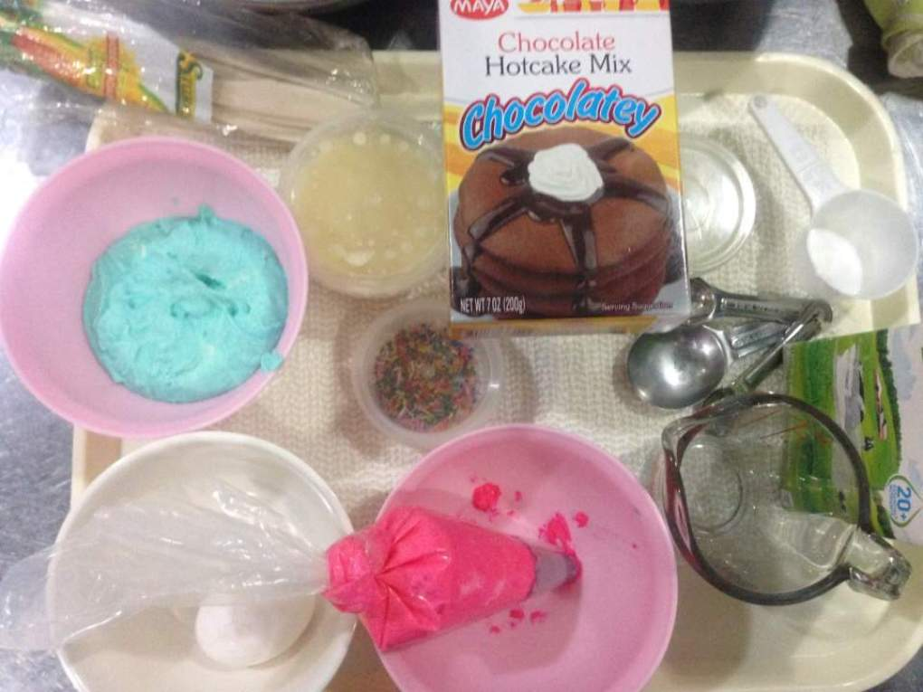 chocolate hotcake mix and buttercream ready for making chocolate cupcakes