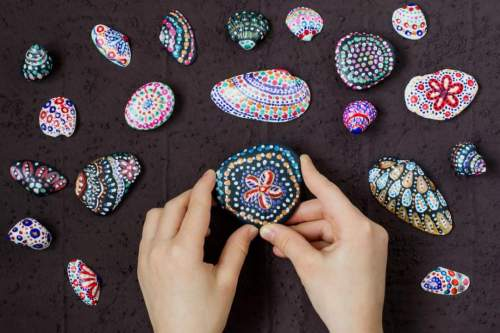 Children's Summer Art Project: Hand-painted colorful dot patterns on sea pebbles and shells