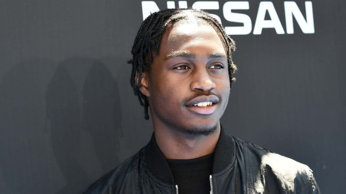 Rapper Lil Tjay arrested for gun and weed possession
