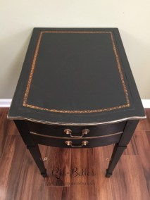 Painted leather top of the black side table
