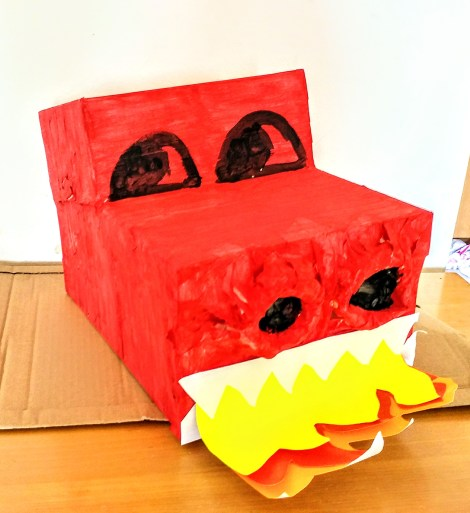 Cute cardboard box dragon painted red with teeth & flames!