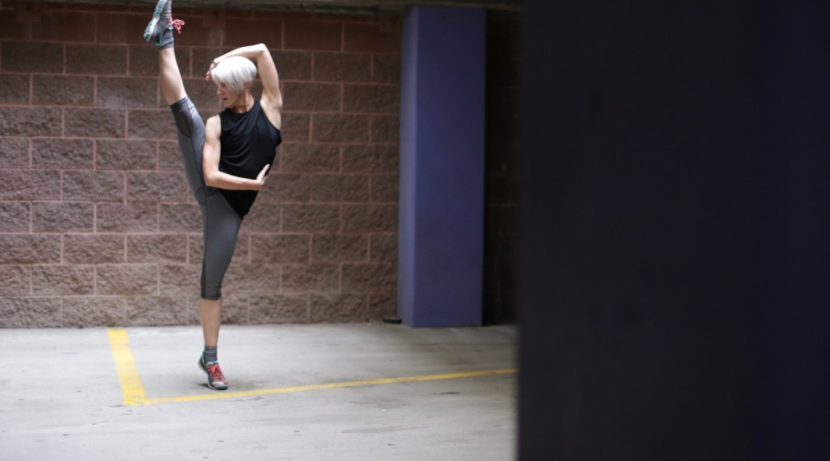 dancer in parking garage t20 4EZVmO