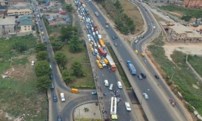 40-ft container falls off trailer on Otedola Bridge, crushes 2 cars, one dead