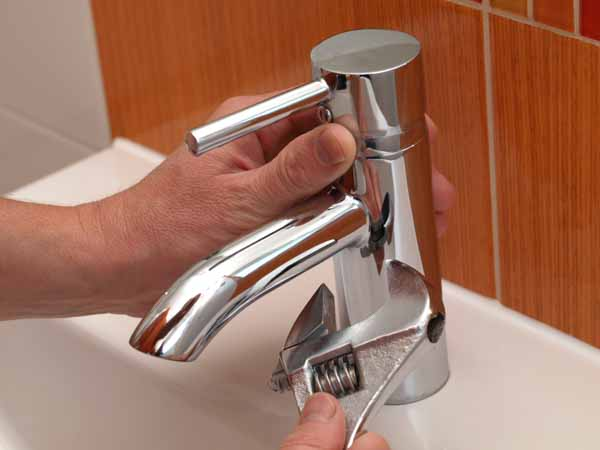 Loveland CO plumber fixing faucet