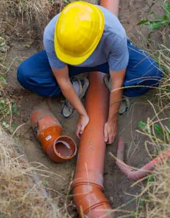 Plumber doing trenchless sewer repair in loveland, co by Relief Home Services