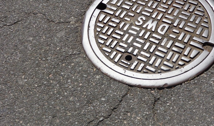 manhole leading to sewer for trenchless sewer repair by a plumber