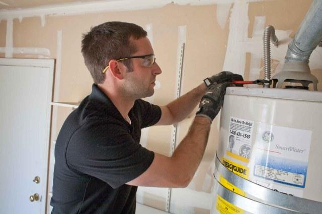Fort Collins plumber repairing hot water heater.