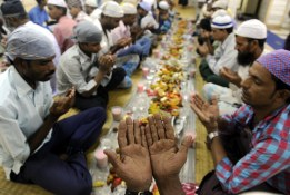 Muslim people offer prayers before break their fast in a Masjid in Mumbai - Salman Ansari.DNA