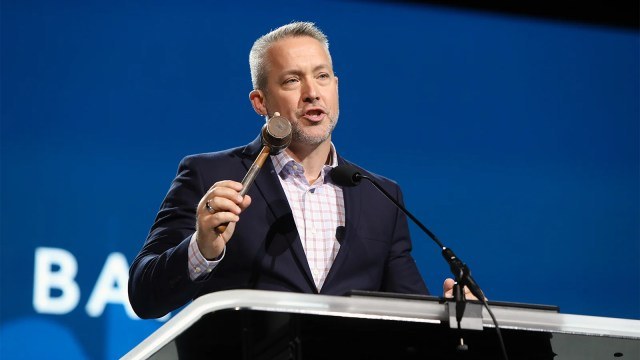 Southern Baptist Convention President J.D. Greear uses the Judson gavel during the opening of the annual meeting June 15, 2021, at the Music City Center in Nashville, Tennessee. RNS photo by Kit Doyle