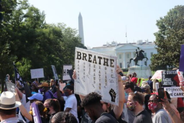 Participants in March On for Voting Rights pass the White House and Black Lives Matter Plaza on August 28, 2021. RNS photo by Adelle M. Banks