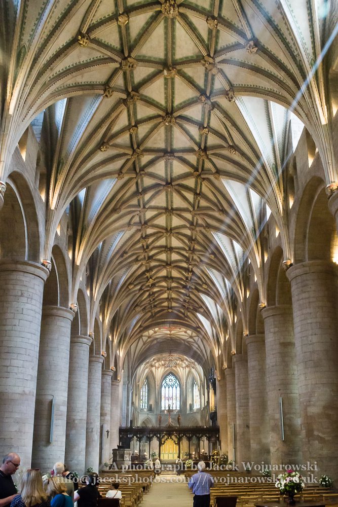 Nave of Tewkesbury Abbey, Parish Church of St Mary the Virgin Facade Norman Arch candid people