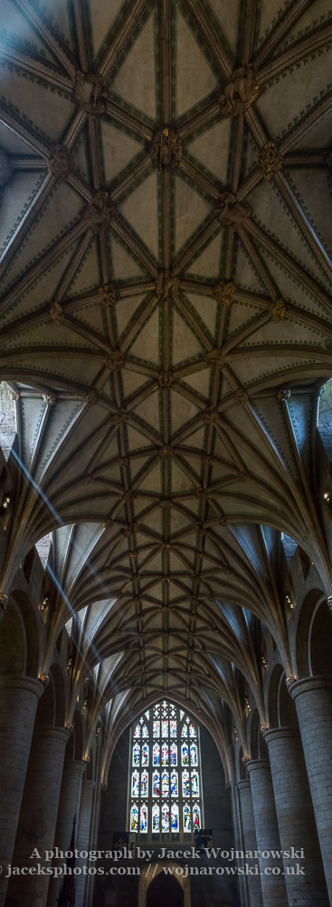 Stained glass and Ceiling of Tewkesbury Abbey, panoramic vertical view