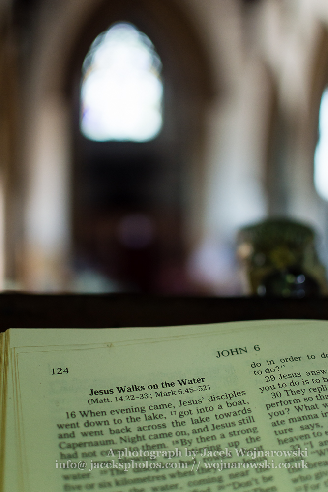 Bible on the lectern, Shallow depth of field vertical photography, sharp text Jesus Walks on the Water