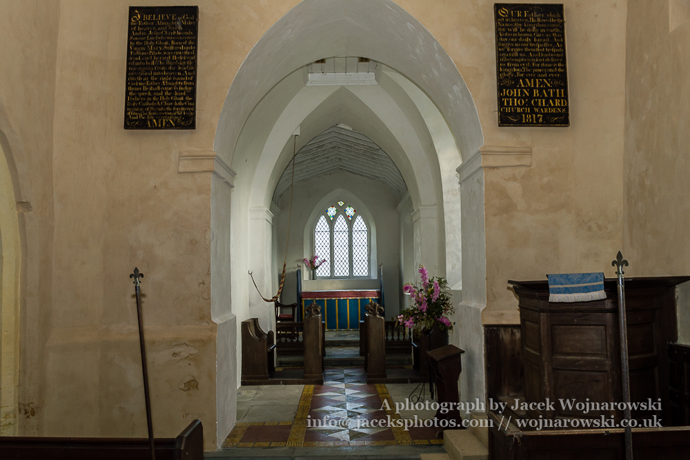 Nave with Pulpit of Church of The Blessed Virgin Mary in Somerset, England is medieval in origin but underwent extensive renovation in the 18th century