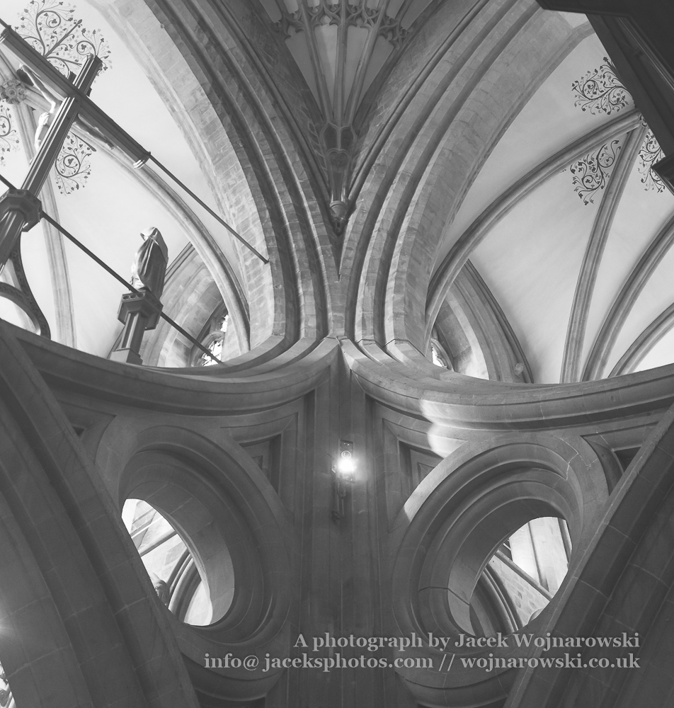 Wells Cathedral Scissor Arch inside low angle vertical black and white photography