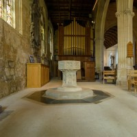 Holy Trinity Church Font and Organ in background