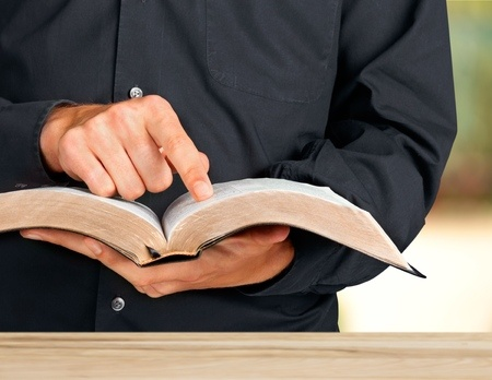 headmaster with bible