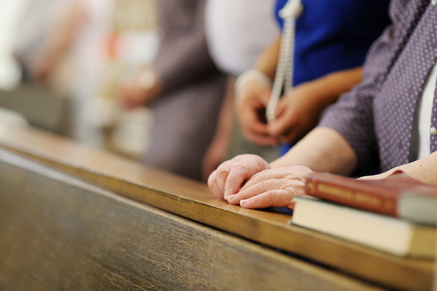 Senior woman praying in a church