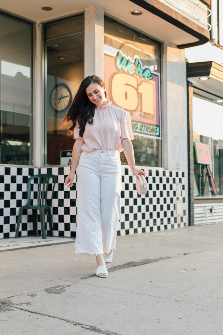 Los Angeles blogger, RELish By Arielle, wears white wide leg jeans, asos mules and a turtleneck blouse from Mango