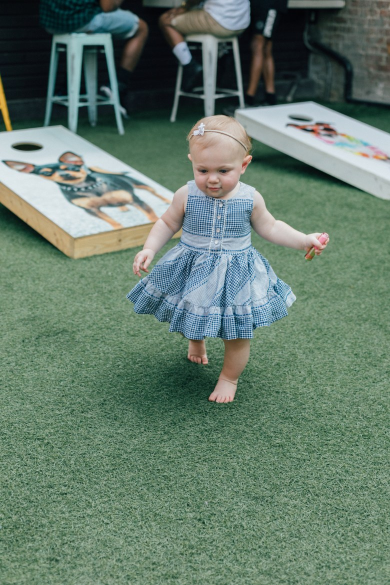 Los Angeles blogger, RELish By Arielle's baby, wears an Oshkosh dress from Target