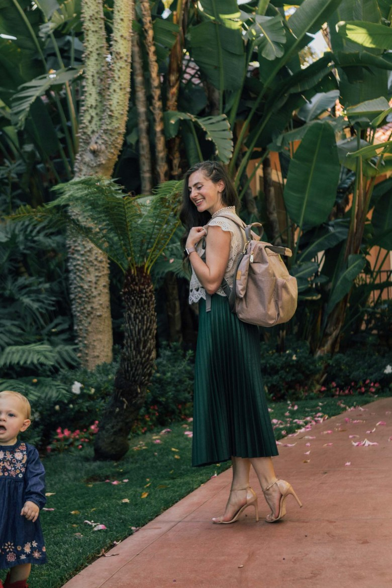 Los Angeles blogger, RELish By Arielle wears a green maxi accordion skirt from Zara