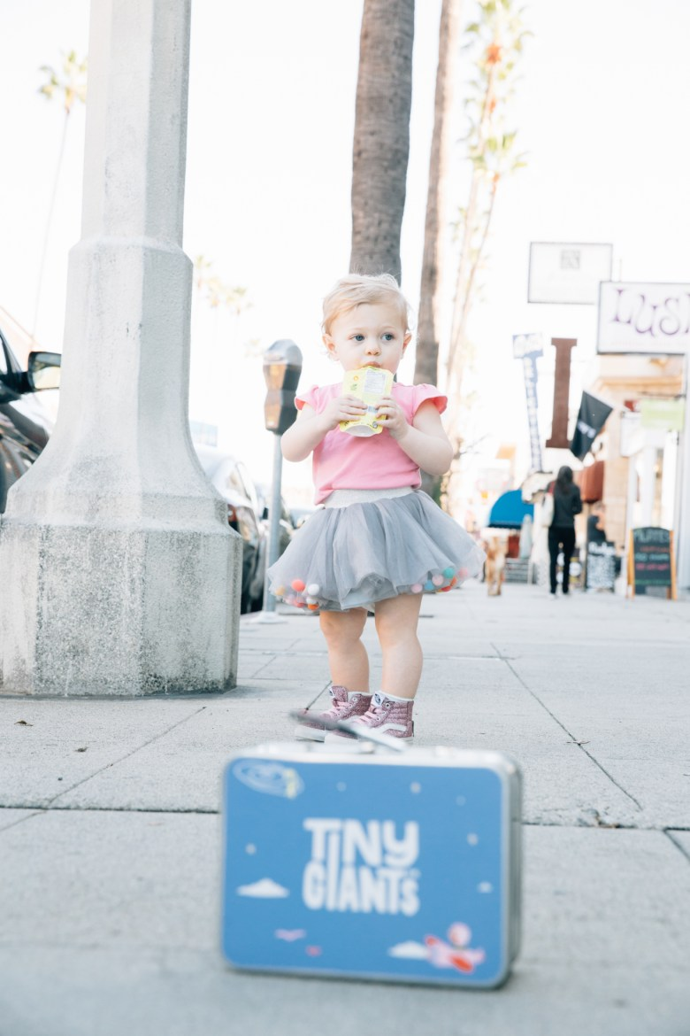 Los Angeles mom blogger, RELish By Arielle's daughter wears a tulle skirt with pom moms