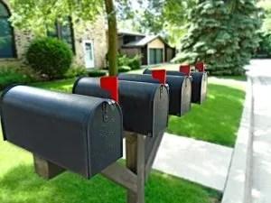 Four black mailboxes