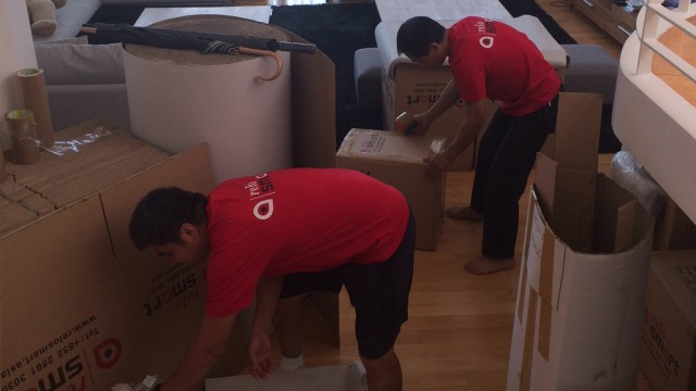 ReloSmart movers packing cardboard boxes and offering moving service Hong Kong