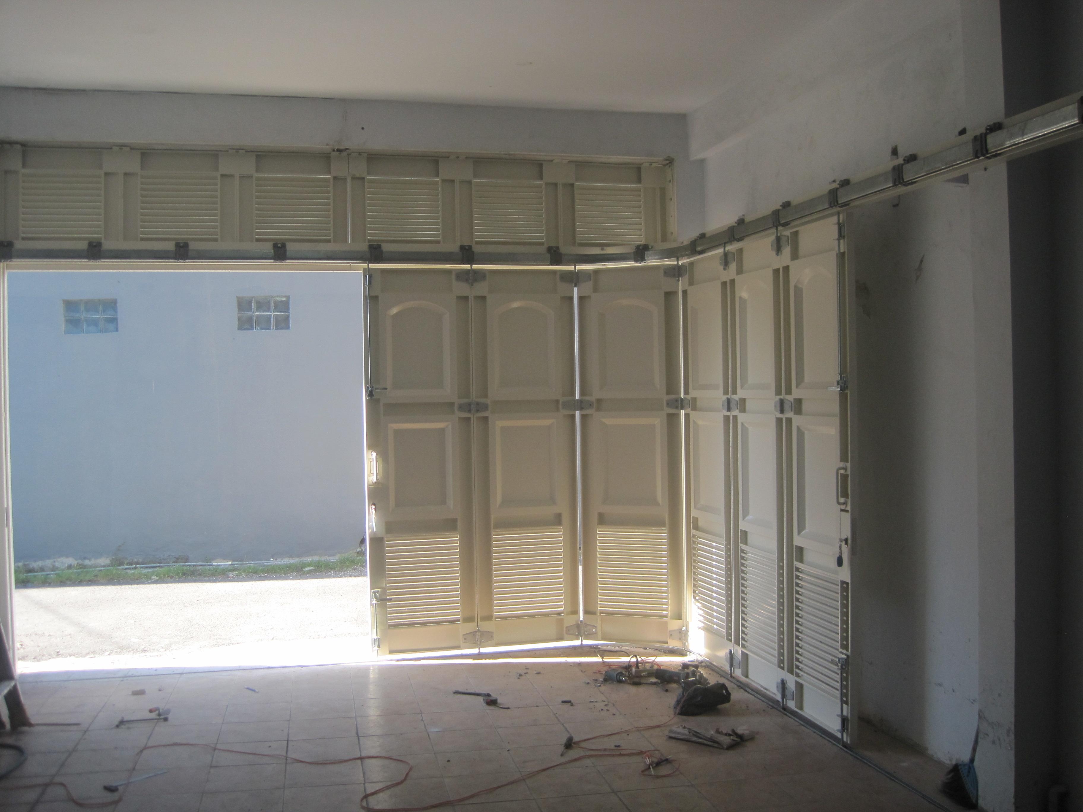Pusat Pintu Garasi Besi Wina  Rel Pintu Garasi Wina