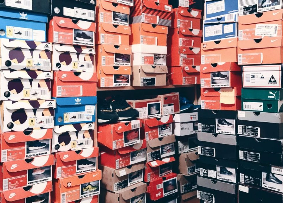 Stacks of Nike and adidas shoe boxes