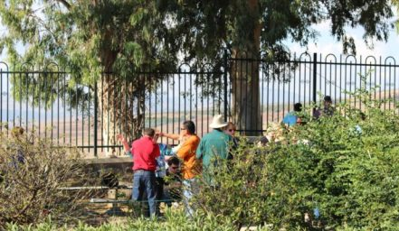 There's power in prayer. These people visiting the Mount of The Beatitudes in Israel laid hands on one another.