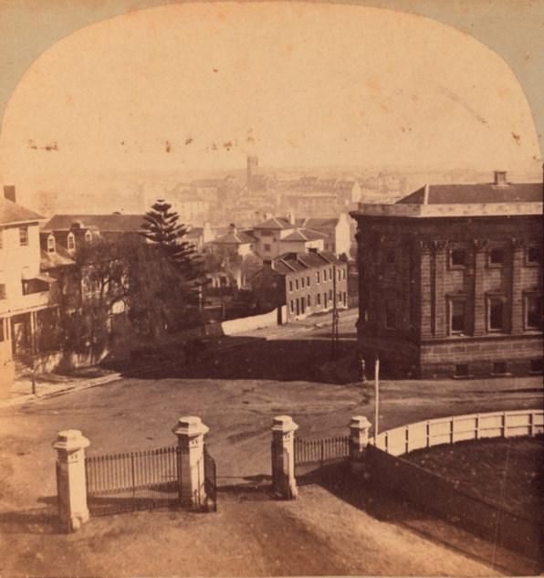 Corner Macquarie Street and Bent Street, looking west. The elevated viewpoint indicates the photograph was made from the tower erected over the Sir Richard Bourke statue in May 1859
